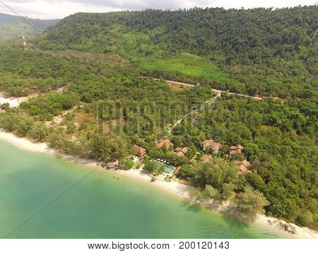 Bird's eye view of Thailand's east coast beach and the tropical forest in Trat Province by drone