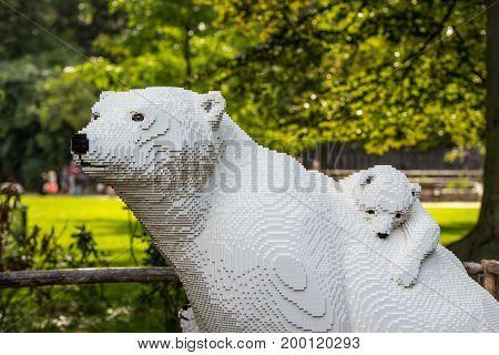 Planckendael zoo Mechelen Belgium - AUGUST 17 2017 : White polar bear and baby bear built from lego bricks temporary exposition at Planckendael zoo.