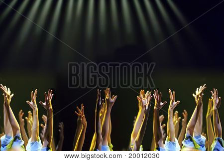 The crowds waving arms to cheer at performance