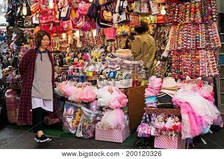 Seoul Korea - April 04 2017: Woman in front of the souvenir shop in Namdaemun market. Namdaemun market is a large traditional market in Seoul South Korea.