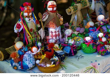 Doll is made of fabric. Sewn doll in a traditional costume, handmade. Doll motanka. Russian tradition the hand-made. A toy from fabric.