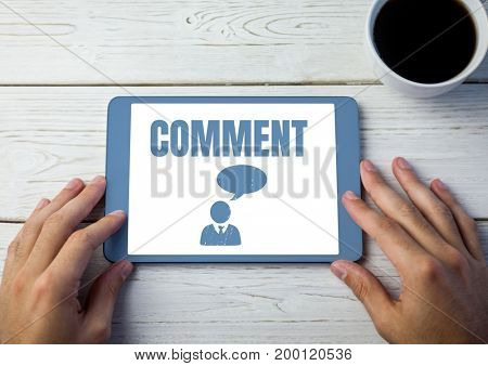 Digital composite of Comment text and chat graphic on tablet screen with hands