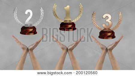 Digital composite of Women with trophies on hands