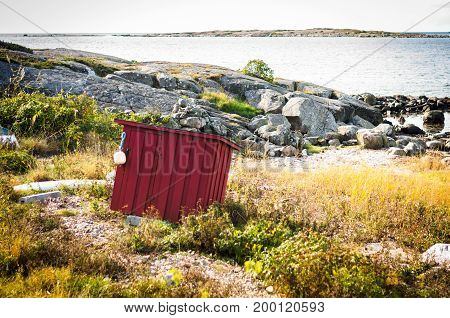 lonely falun red wooden barn at coast of sweden
