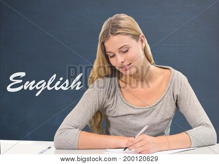Digital composite of Student girl at table against blue blackboard with English text