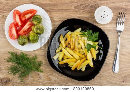 Plate With Fried Potatoes, Tomatoes, Brussels Sprouts, Salt, Dill