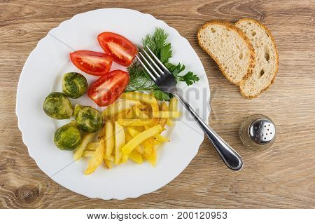 White Dish With Fried Potatoes, Tomatoes, Brussels Sprouts, Greens, Bread