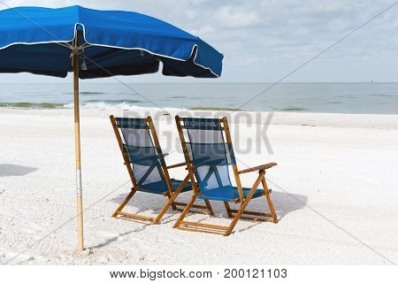 Two lounge chair and sun umbrellas on Clearwater Beach, Florida, USA