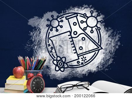 Digital composite of Desk foreground with blackboard graphics of science objects