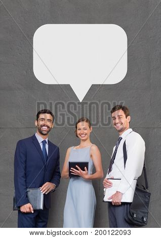 Digital composite of Happy business people with speech bubble holding devices against grey background