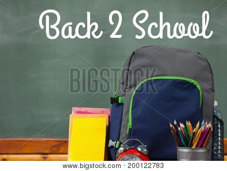 Digital composite of Schoolbag on Desk foreground with blackboard graphics of Back 2 School