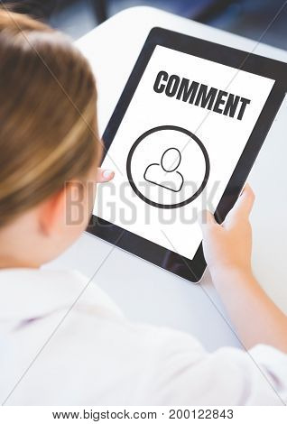 Digital composite of Comment text and chat graphic on tablet screen with womans hands