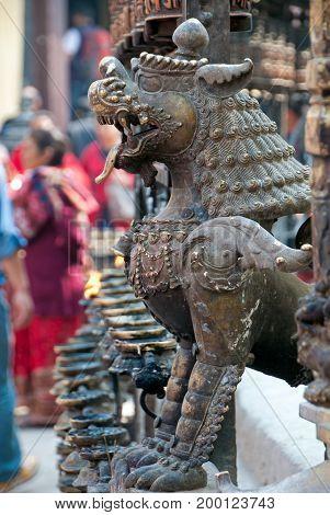 Temple Guardian Lion Statue At Swayambhunath Temple In Kathmandu Valley, Nepal.