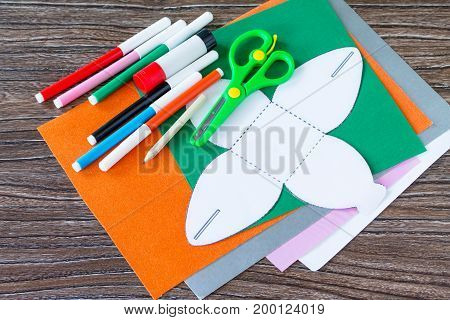 Create A Gift Box. Glue, Scissors, Leaves Of Colored Paper On A Wooden Table. Children's Art Project