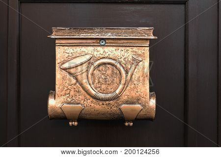 vintage brass mailbox on the door of an old house in Budapest closeup