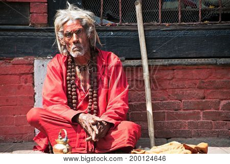Kathmandu, Nepal - March 9, 2013: Lone Sadhu In Pashupanith Temple. A Sadhu Is A Religious Ascetic,