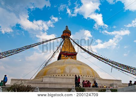 Katmandu Nepal - March 9 2013: People at Boudhanath Stupa Temple. Boudhanath Stupa (or Bodnath Stupa) is the largest stupa in Nepal and the holiest Tibetan Buddhist temple outside Tibet.