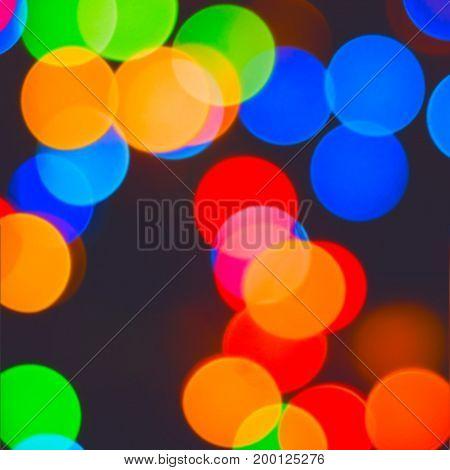 Celebratory background lights in blur round multicolored balls