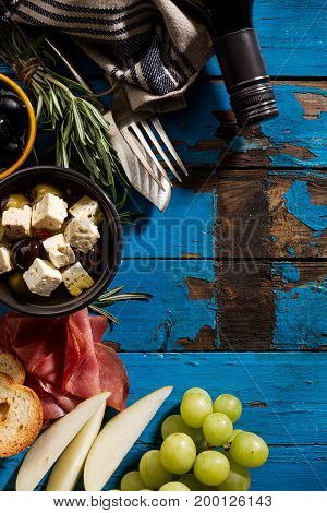 Tasty appetizing italian Mediterranean Food Ingredients Flat Lay on Blue Old Rustic Background Top View Copy Space Above