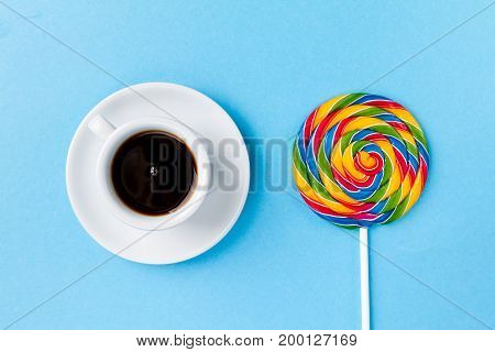 Tasty appetizing Party Accessory Sweet Treat Swirl Candy Lollypop with Coffee Espresso on Bright Background Top View Minimalism Fashion Conceptual