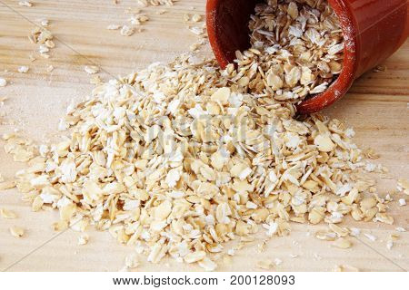 image of raw organic oatmeal flakes.food for breakfast