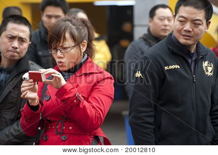 A girl looking at her pictures just taken
