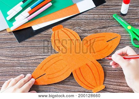 Create A Gift Box Of Halloween Pumpkin. The Child Draws Details Of The Application Of The Box. Child