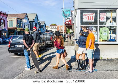 Bar Harbor USA - June 8 2017: Young people crossing street in downtown village on vacation in summer