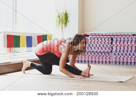 Woman Makes Yoga Exercises