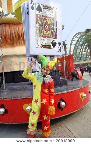 clown in front of playing card king