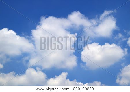 Pure White Fluffy Cloud Floating on Vivid Blue Tropical Summer Sky of Thailand