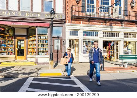Bar Harbor USA - June 8 2017: Old local independent bookstore called Sherman's exterior in downtown village on vacation in summer with signs and people crossing street