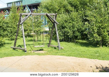 Large Wooden Swing On The Playground.