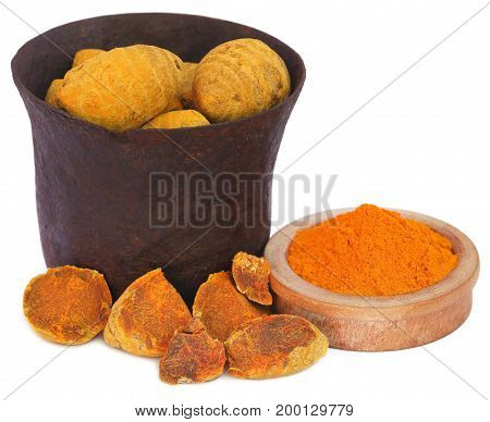 Turmeric in a vintage bowl over white background