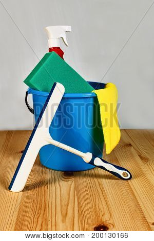 a bucket, sponge and scraper standard cleaning kit closeup as background