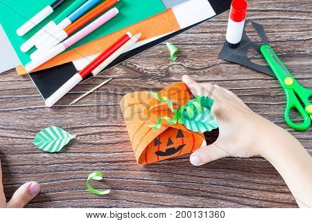 Create A Gift Box Of Halloween Pumpkin. The Child Glues The Details Of The Application Of The Box. C