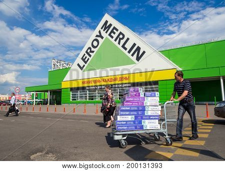 Voronezh, Russia - May 26, 2017: Customers with goods leave the hypermarket