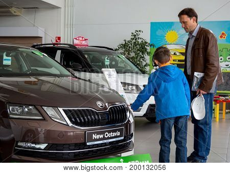 Voronezh, Russia - June 04, 2017: Dad and son choose a new car