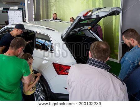 Voronezh, Russia - June 04, 2017: Many people are considering a new car in the showroom