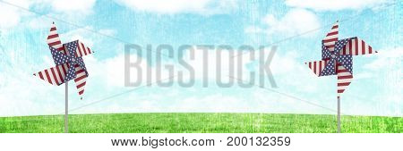 Digital composite of USA wind catchers in front of grass and sky