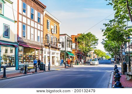 Bar Harbor USA - June 8 2017: Empty main street in downtown village in summer with people and stores