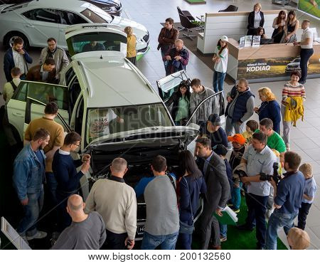Voronezh, Russia - June 04, 2017: A crowd of people near the new car in the showroom