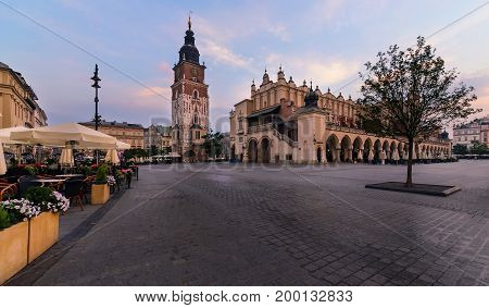 The main square of Krakow Poland. Europe in the early morning in summer time.