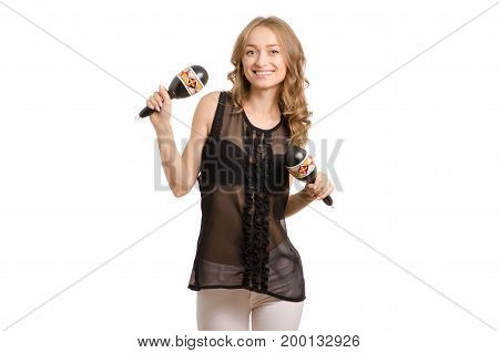 Beautiful young woman with maracas dancing on white background isolation