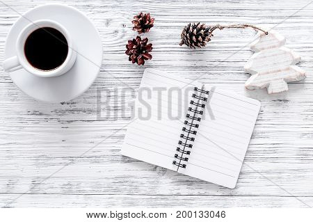 Plan for the year. Notebook and cup of coffee on grey wooden background top view.