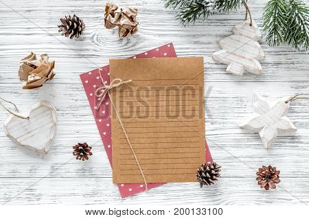 Plan for the year. Sheet of paper, cup of coffee and christmas decoration on grey wooden background top view.