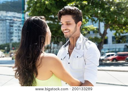Young caucasian couple in love outdoor in the city in the summer