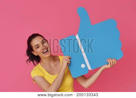 Beautiful young woman girl with cartoon like icon on colorful background. Yellow, pink and blue colors.