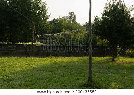 An old volleyball net on a country plot.