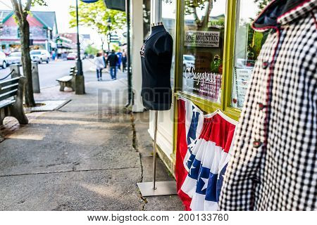 Bar Harbor USA - June 8 2017: Sidewalk in Maine downtown village in summer by stores